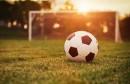 soccer-ball-on-field-near-against-setting-sun
